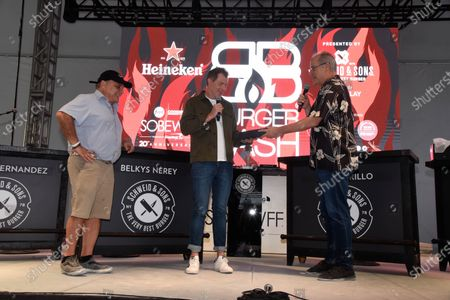 Ian Shrager, from left, Chef Bobby Flay - receives the Key to the City of Miami Beach, from Mayor of Miami Beach Dan Gelber at Burger Bash at the 20th South Beach Wine and Food Festival in Miami Beach, Florida, USA - 21 May 2021