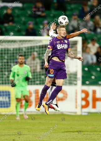 Andy Keogh of Perth Glory wins the heading duel with Mark Milligan of Macarthur FC; HBF Park, Perth, Western Australia, Australia; A League Football, Perth Glory versus Macarthur.