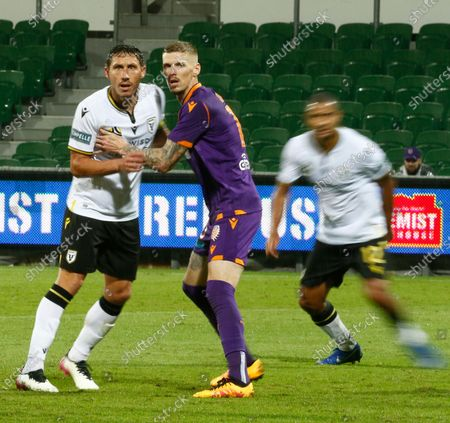 Andy Keogh of Perth Glory and Mark Milligan of Macarthur FC grapple for position for the Macarthur cross; HBF Park, Perth, Western Australia, Australia; A League Football, Perth Glory versus Macarthur.
