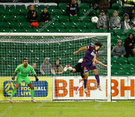 Adam Federici of Macarthur FC sets himself for the header from Nicholas D'Agostino of Perth Glory while Mark Milligan tries to block the effort; HBF Park, Perth, Western Australia, Australia; A League Football, Perth Glory versus Macarthur.