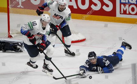Hannes Bjorninen (R) of Finland in action against US players Eric Robinson (L) and Christian Wolanin (C) during the IIHF Ice Hockey World Championship 2021 group B match between Finland and the USA at the Arena Riga, Latvia, 22 May 2021.