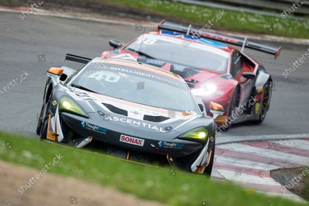Nick Halstead & Jamie Stanley, McLaren 570S GT4, Fox Motorsport pursued through Stirlings by Michael Igoe & Phil Keen, Lamborghini Huracan GT3 EVO, WPI Motorsport during Round 1 Practice and Qualifying of the British GT Championship at Brands Hatch Circuit on 22nd May 2021