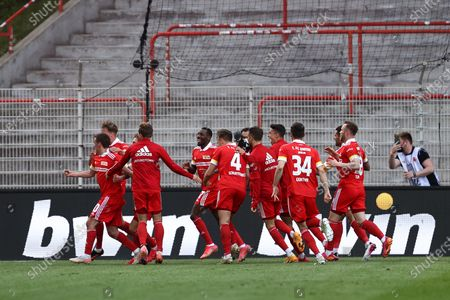 Max Kruse of 1. FC Union Berlin celebrates with team mates after scoring their side's second goal during the German Bundesliga soccer match between FC Union Berlin and RB Leipzig in Berlin, Germany, 22 May 2021.