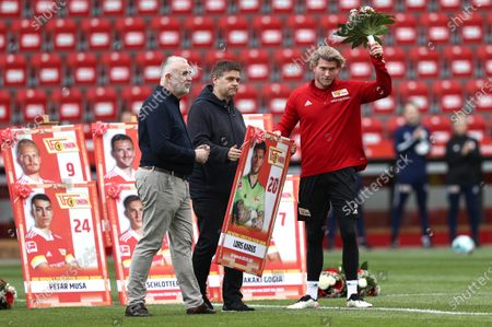 Stock Image of Union's goalkeeper Loris Karius (R) receives a gift for his service at the club prior to the German Bundesliga soccer match between FC Union Berlin and RB Leipzig in Berlin, Germany, 22 May 2021.