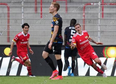 Union's Max Kruse, right, celebrates his side's winning goal during the German Bundesliga soccer match between 1. FC Union Berlin and RB Leipzig in Berlin, Germany