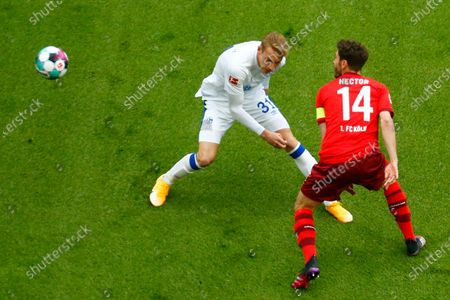 Schalke's Timo Becker (L) and Cologne's Jonas Hector (R) in action during the German Bundesliga soccer match between FC Cologne and Schalke 04 in Cologne, Germany, 22 May 2021.