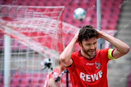 Stock Picture of Cologne's Jonas Hector reacts after missing a chance at goal during the German Bundesliga soccer match between FC Koeln and FC Schalke 04 in Cologne, Germany, 22 May 2021.