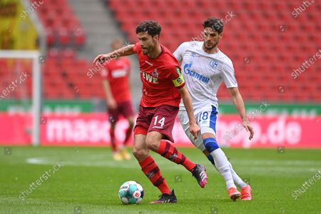 Cologne's Jonas Hector (L) and Schalke's Goncalo Paciencia (R) in action during the German Bundesliga soccer match between FC Koeln and FC Schalke 04 in Cologne, Germany, 22 May 2021.