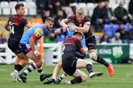 Louis Brown of Coventry Rugby is double tackled by Jackson Wray and Nick Tompkins of Saracens