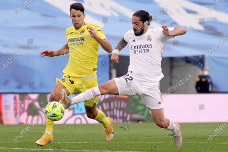 Real Madrid's midfielder 'Isco' Alarcon (R) fights for the ball with Villarreal's player Alfonso Pedraza during the Spanish LaLiga Primera Division soccer match between Real Madrid and Villarreal at Alfredo Di Stefano stadium in Madrid, central Spain, 22 May 2021.