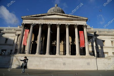 Stock Image of A woman takes a selfie outside the National Gallery of art in London. Tony Hall, who was director of BBC news and current affairs at the time of the public broadcaster's explosive 1995 interview with Princess Diana, resigned Saturday May 22, 2021, as board chairman of Britain's National Gallery