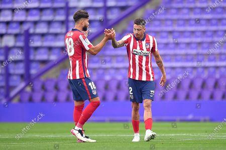 Felipe Augusto de Almeida and José Maria Gimenez of Atletico de Madrid