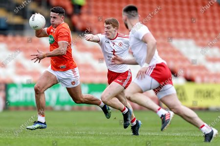 Armagh vs Tyrone. Armagh's Stefan Campbell and Michael O'Neill of Tyrone