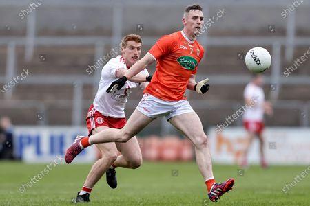 Armagh vs Tyrone. Armagh's Ciaron O'Hanlon and Michael O'Neill of Tyrone