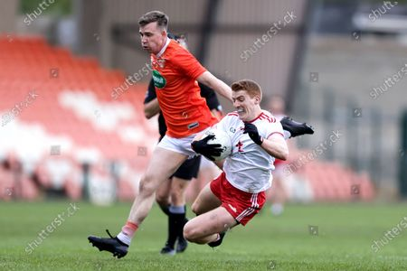 Armagh vs Tyrone. Tyrone's Michael O'Neill is tackled by Paul Hughes of Armagh