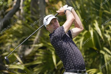 Martin Laird, of Scottland, watches his ball on the second tee during the third round at the PGA Championship golf tournament on the Ocean Course, in Kiawah Island, S.C