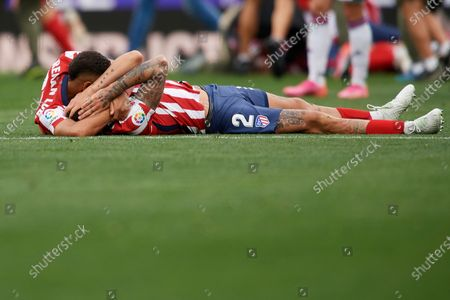 Jose Maria Gimenez and Renan Lodi Atletico players celebrate after winning the league championship after the La Liga Santander match between Real Valladolid CF and Atletico de Madrid at Estadio Municipal Jose Zorrilla on May 22, 2021 in Valladolid, Spain. Sporting stadiums around Spain remain under strict restrictions due to the Coronavirus Pandemic as Government social distancing laws prohibit fans inside venues resulting in games being played behind closed doors