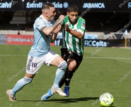 Celta Vigo's Iago Aspas (L) in action against Real Betis' Nabil Fekir (R) during the Spanish LaLiga Primera Division soccer match between Celta Vigo and Betis in Vigo, Spain, 22 May 2021.