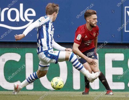 Osasuna's Roberto Torres (R) in action against Real Sociedad's Nacho Monreal (L) during a Spanish LaLiga soccer match between Osasuna and Real Sociedad at El Sadar stadium in Pamplona, Navarra, Spain, 22 May 2021.