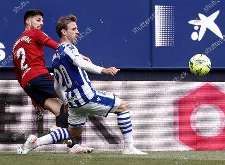 Osasuna's Nacho Vidal (L) in action against Real Sociedad's Nacho Monreal (R) during a Spanish LaLiga soccer match between Osasuna and Real Sociedad at El Sadar stadium in Pamplona, Navarra, Spain, 22 May 2021.