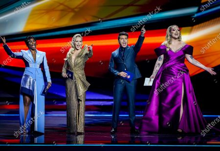 Presenters Edsilia Rombley, Chantal Janzen, Jan Smit and Nikkie de Jager during the Grand Final of the 65th annual Eurovision Song Contest (ESC) at the Rotterdam Ahoy arena, in Rotterdam, The Netherlands, 22 May 2021. Due to the coronavirus (COVID-19) pandemic, only a limited number of visitors is allowed at the 65th edition of the Eurovision Song Contest (ESC2021) that is taking place in an adapted form at the Rotterdam Ahoy.