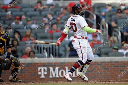 Atlanta Braves' Marcell Ozuna bats against the Pittsburgh Pirates during a baseball game, in Atlanta