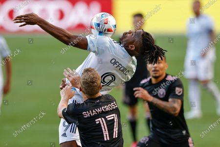 Chicago Fire forward Chinonso Offor (9) goes up for a header against Inter Miami defender Ryan Shawcross (17) during the second half of an MLS soccer match, in Chicago