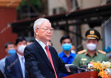 Vietnam's Communist Party General Secretary Nguyen Phu Trong, foreground, speaks to the media after voting at a polling station in Hanoi, Vietnam . Vietnamese cast their ballots to elect 500 delegates for a five-year term at the National Assembly, Vietnam's legislative body, as the country is combating a new wave of COVID-19