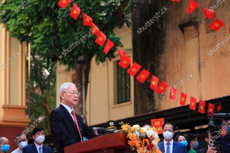 Stock Photo of Vietnam's Communist Party General Secretary, foreground, Nguyen Phu Trong speaks to the media after voting at a polling station in Hanoi, Vietnam . Vietnamese cast their ballots to elect 500 delegates for a five-year term at the National Assembly, Vietnam's legislative body, as the country is combating a new wave of COVID-19