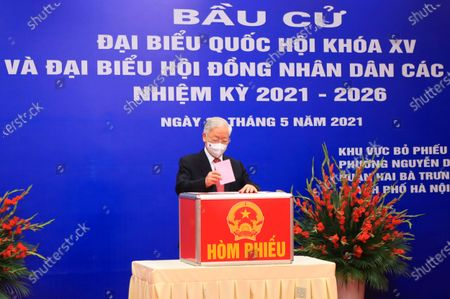 Vietnam's Communist Party General Secretary Nguyen Phu Trong votes at a polling station in Hanoi, Vietnam . Vietnamese cast their ballots to elect 500 delegates for a five-year term at the National Assembly, Vietnam's legislative body, as the country is combating a new wave of COVID-19