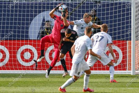 Inter Miami goalkeeper John McCarthy, left, defends against the Chicago Fire during the first half of an MLS soccer match, in Chicago