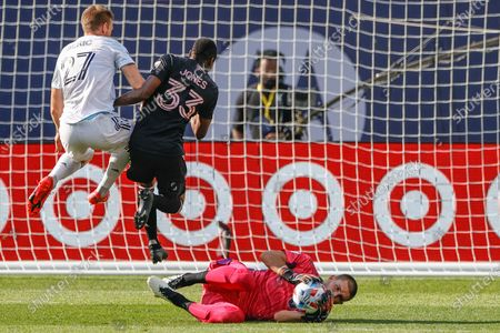 Inter Miami goalkeeper John McCarthy, right, defends against the Chicago Fire during the first half of an MLS soccer match, in Chicago