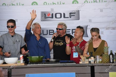 Stock Photo of From Left, Hunter Fieri, Geoffrey Zakarian, Guy Fieri and Jet Tila attend the Food Demonstration event during the Grand Tasting at the South Beach Wine and Food Festival in Miami Beach, Florida, USA - 22 May 2021