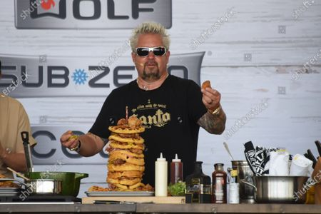 Guy Fieri builds a tower of food at the Food Demonstration event during the Grand Tasting at the South Beach Wine and Food Festival in Miami Beach, Florida, USA - 22 May 2021