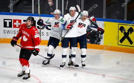 Jason Robertson (C), Trevor Moore (R) and Ryan Donato of USA celebrate a goal during the IIHF 2021 World Ice Hockey Championships group B match between Canada and USA at the Arena Riga, Latvia, 23 May 2021.