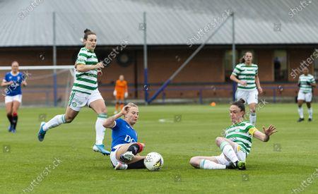 Rangers Women's Defender Rachel McLauchlan and Celtic Women's Midfielder Kelly Clark slide to win the ball