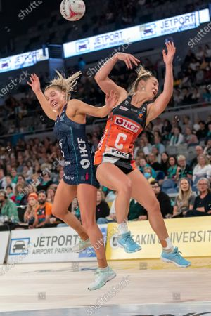 Jamie-Lee Price and Kate Moloney compete for the ball.