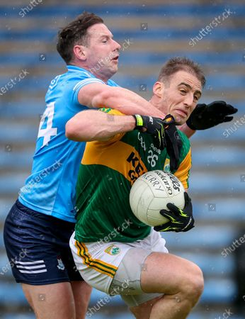 Stock Image of Dublin vs Kerry. Dublin's Philly McMahon concedes a penalty for tackling Stephen O'Brien of Kerry