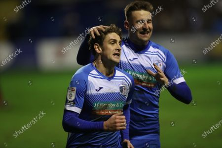 Harrison Biggins of Barrow celebrates with Scott Quigley after scoring their third goal during the Sky Bet League 2 match between Barrow and Cheltenham Town at the Holker Street, Barrow-in-Furness on Saturday 19th December 2020.