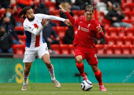 Liverpool's Roberto Firmino, right, competes for the ball with Crystal Palace's Jairo Riedewald during the English Premier League soccer match between Liverpool and Crystal Palace at Anfield stadium in Liverpool, England
