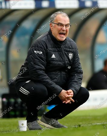 Stock Photo of Leeds United's head coach Marcelo Bielsa shouts out during the English Premier League soccer match between Leeds United and West Brom at Elland Road in Leeds, England