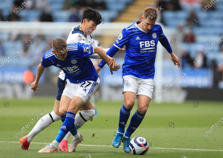 Tottenham's Son Heung-min, center, duels for the ball with Leicester's Timothy Castagne, left, and Leicester's Marc Albrighton during the English Premier League soccer match between Leicester City and Tottenham Hotspur at the King Power Stadium, in Leicester, England