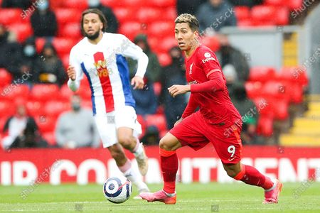 Liverpool forward Roberto Firmino (9) runs forward during the Premier League match between Liverpool and Crystal Palace at Anfield, Liverpool