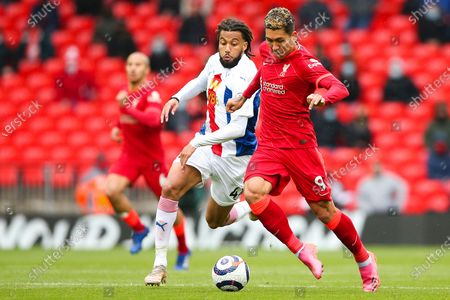 Liverpool forward Roberto Firmino (9) and Crystal Palace midfielder Jaïro Riedewald (44) during the Premier League match between Liverpool and Crystal Palace at Anfield, Liverpool
