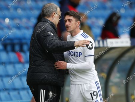 Stock Picture of Pablo Hernandez (R) of Leeds hugs Leeds United's manager Marcelo Bielsa during the English Premier League soccer match between Leeds United and West Bromwich Albion in Leeds, Britain, 23 May 2021.