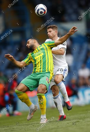 Gaetano Berardi (R) of Leeds in action against Matt Phillips of West Bromwich during the English Premier League soccer match between Leeds United and West Bromwich Albion in Leeds, Britain, 23 May 2021.