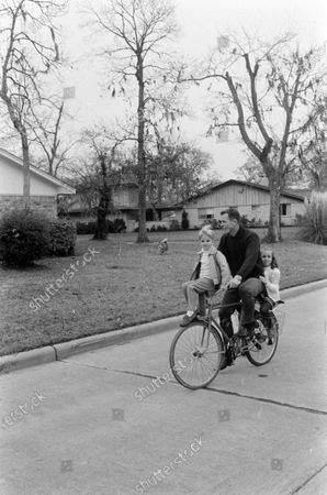 David Scott driving a bicycle, United States, March 1969.