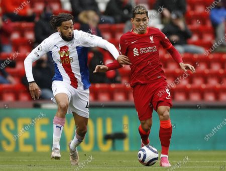 Liverpool's Roberto Firmino (R) in action against Crystal Palace's Jairo Riedewald (L) during the English Premier League soccer match between Liverpool FC and Crystal Palace in Liverpool, Britain, 23 May 2021.