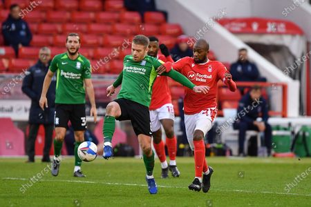 Adam Clayton of Birmingham City holds off Samba Sow of Nottingham Forest during the Sky Bet Championship match between Nottingham Forest and Birmingham City at the City Ground, Nottingham on Saturday 26th December 2020.