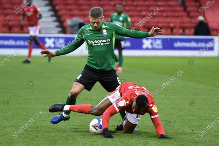 Adam Clayton of Birmingham City fouls Cafu of Nottingham Forest during the Sky Bet Championship match between Nottingham Forest and Birmingham City at the City Ground, Nottingham on Saturday 26th December 2020.